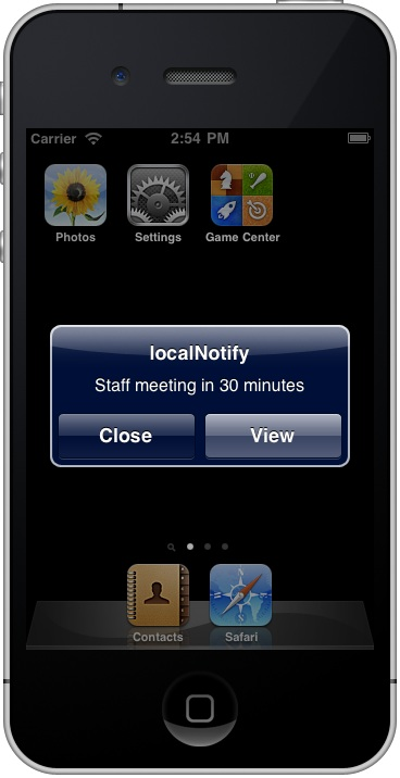 An iOS 4 iPhone local notification message in the iOS Simulator