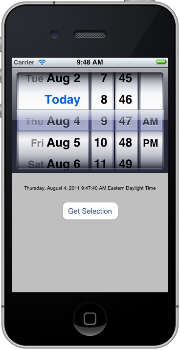 An iOS 5 iPhone UIDatePicker application running